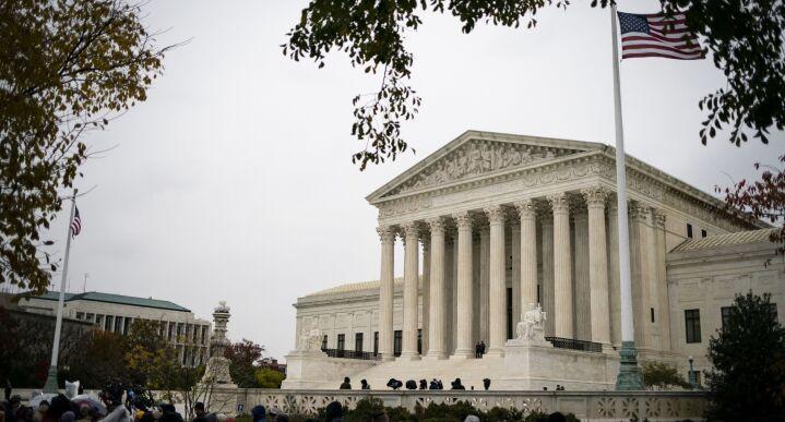 People gather outside the U.S. Supreme Court in Washington, on Nov. 12, 2019.