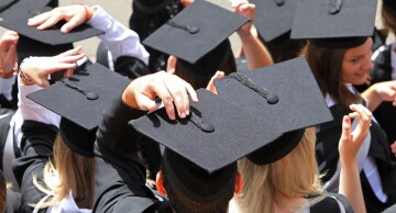 Students take part in graduation ceremony.