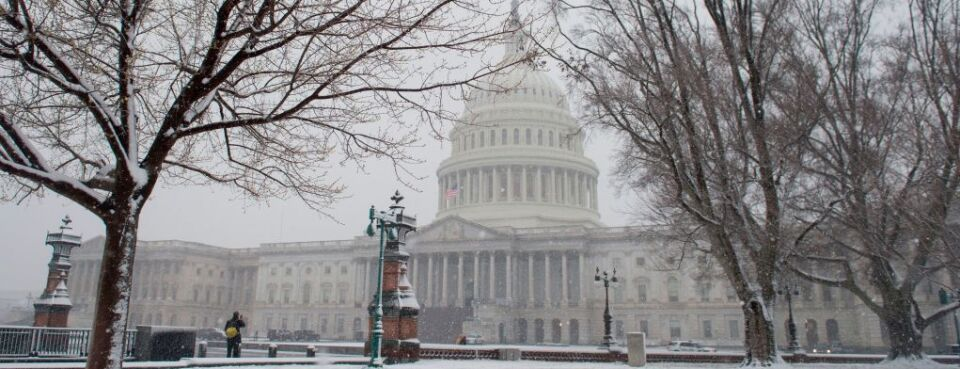 U.S. Capitol in March 2018 snow (used 3/21/18)
