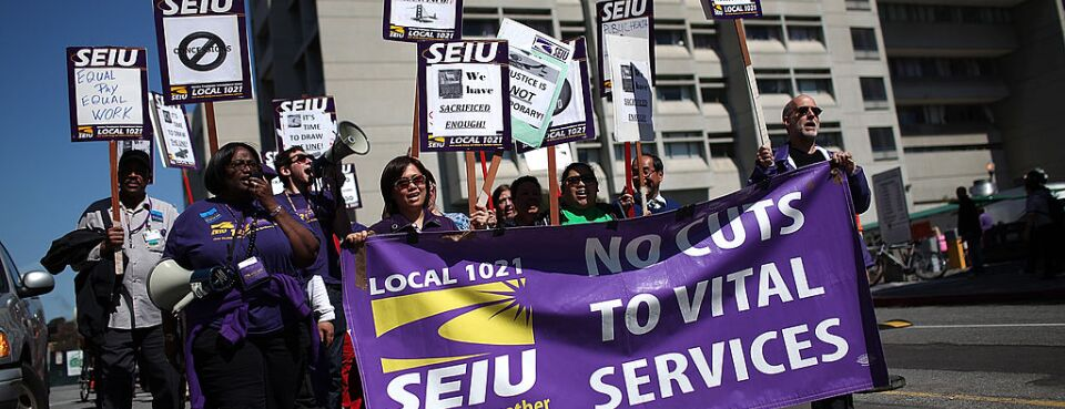 Members of an SEIU local union protest outside a hospital. The NLRB on June 14, 2019, said employers have the right to eject nonemployee union representatives from promoting a union on public areas of company grounds, like cafeterias.