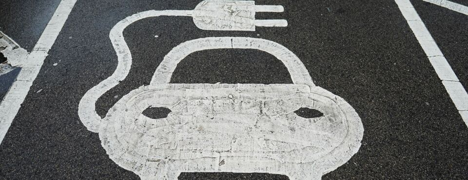 Electric car / EVs - Inisghts: An electric vehicle charging sign at a charging station in the U.K. on Dec. 14, 2020.