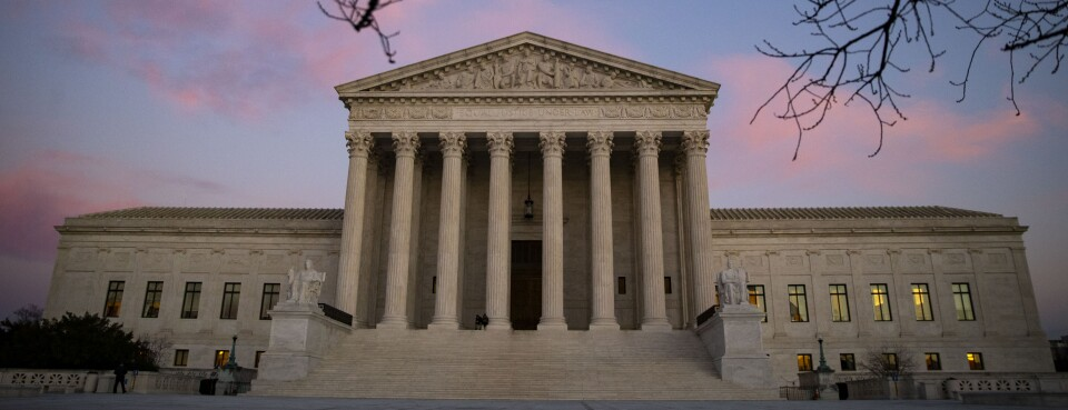 "The U.S. Supreme Court building stands at sunset in Washington, D.C. The National Labor Relations Board's plan to narrow the test for determining when businesses are ""joint employers"" and should share liability for labor violations ultimately may have to get the okay from the Supreme Court."