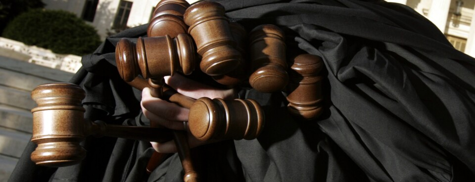 Judges' gavels and robes are seen.