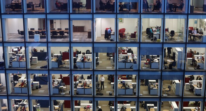 Workers In Offices At Night.