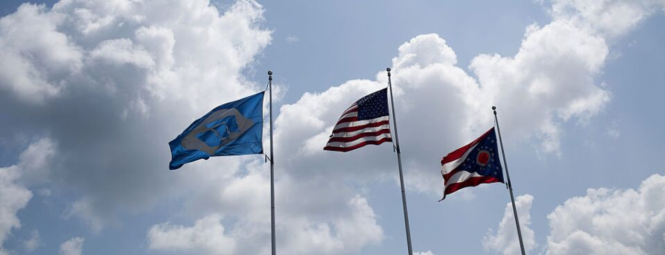 American, Ohio State, and Fuyao Glass flags fly outside of the Fuyao Glass America production facility in Moraine, Ohio.