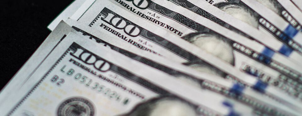 U.S. one-hundred dollar bills are arranged for a photograph.