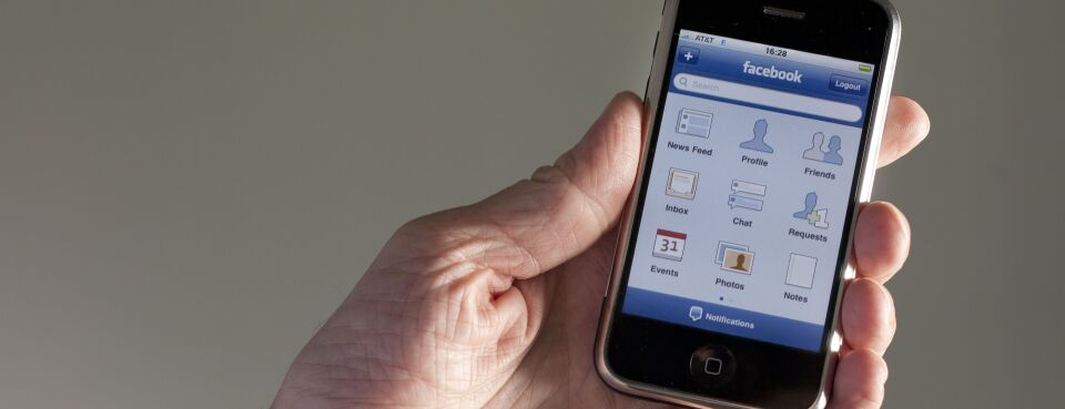 Photo of Facebook app on a mobile phone.