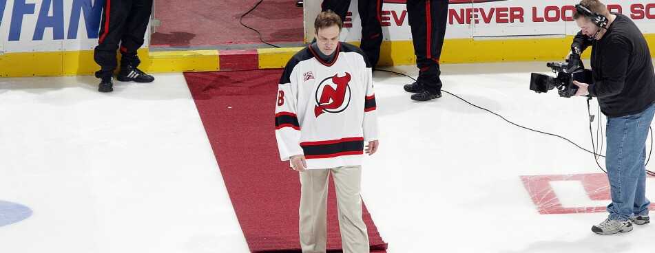 Former New Jersey Devils player Mike Peluso walks to center ice for the  jersey retirement ceremony for Scott Stevens before the game against the  Buffalo ... c99c255c7