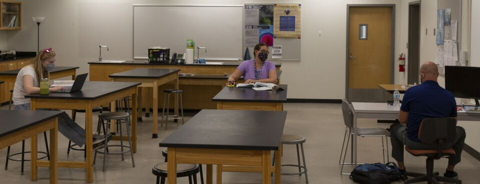 Photo of teachers wearing protective masks at a meeting in a classroom at Catalina Foothills High School in Tucson, Ariz.
