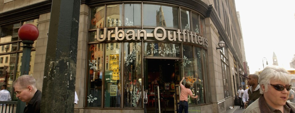 Pedestrians pass in front of 'Urban Outfitters' on 6th Ave. and 14th street in Manhattan.